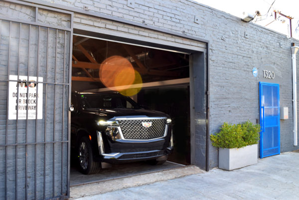 Cadillac Escalade Exiting MG Studio garage front grill