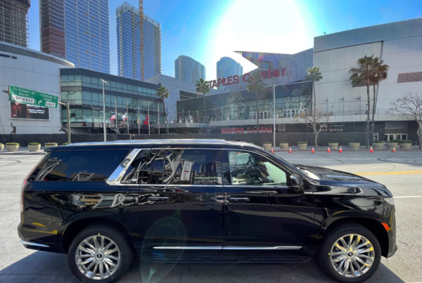 Cadillac Escalade Staples Center in background side view of luxury SUV