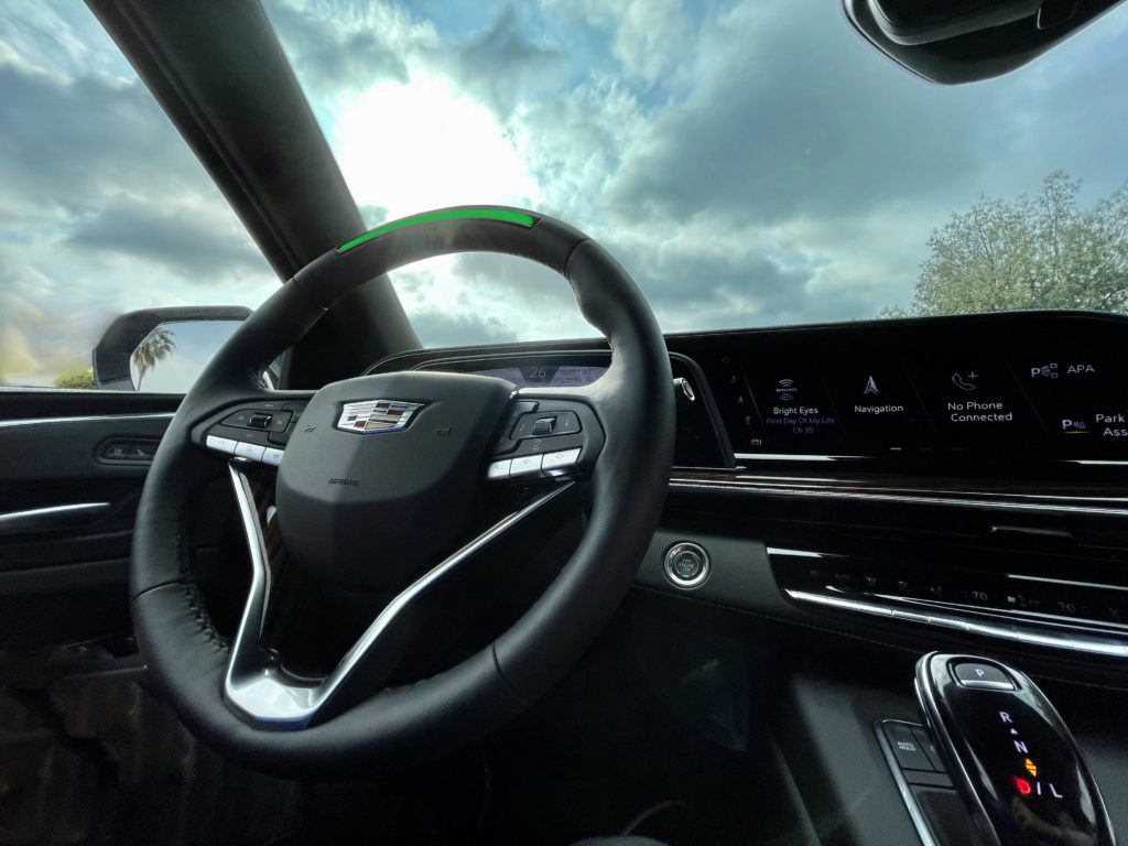 Cadillac Escalade Super Cruise engaged steering wheel interior with bright sky