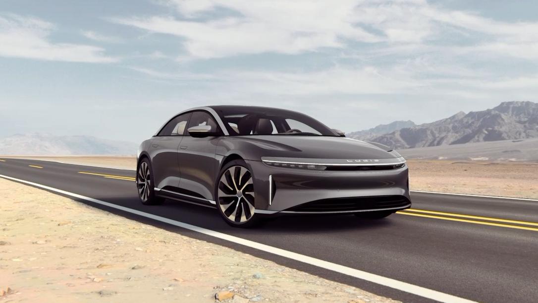 Lucid Air luxury EV sedan sports car driving in desert