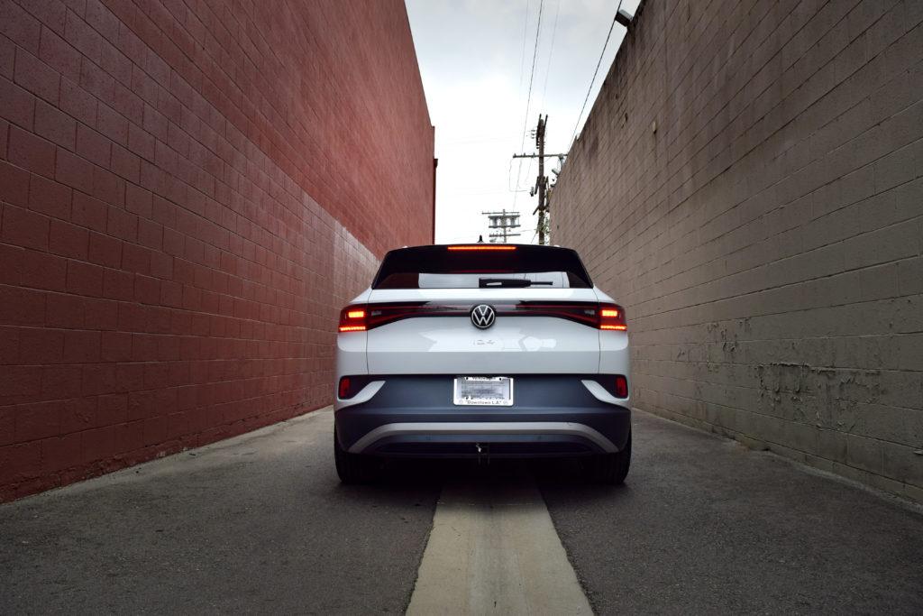 VW ID.4 rear trunk hatch in brown brick alley Los Angeles