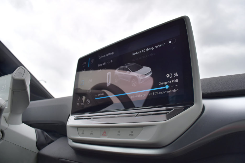 Close-up of VW ID.4 infotainment system screen battery driving range display